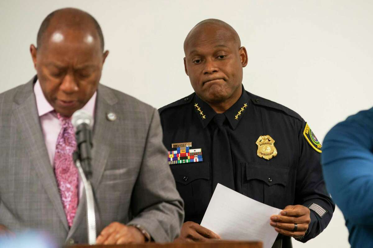 Houston Police Department Chief Troy Finner listens to Houston Mayor Sylvester Turner during a press conference releasing body-worn camera footage of a May 21st officer-involved shooting at a traffic stop, Thursday, June 3, 2021, inside a conference room in HPD's downtown office in Houston.