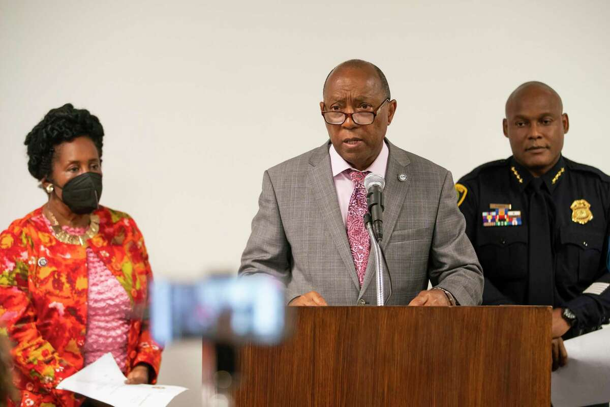 Houston Mayor Sylvester Turner speaks with Congresswoman Sheila Jackson Lee and Houston Police Department Chief Troy Finner during a press conference releasing body-worn camera footage of a May 21st officer-involved shooting at a traffic stop, Thursday, June 3, 2021, inside a conference room in HPD's downtown office in Houston.