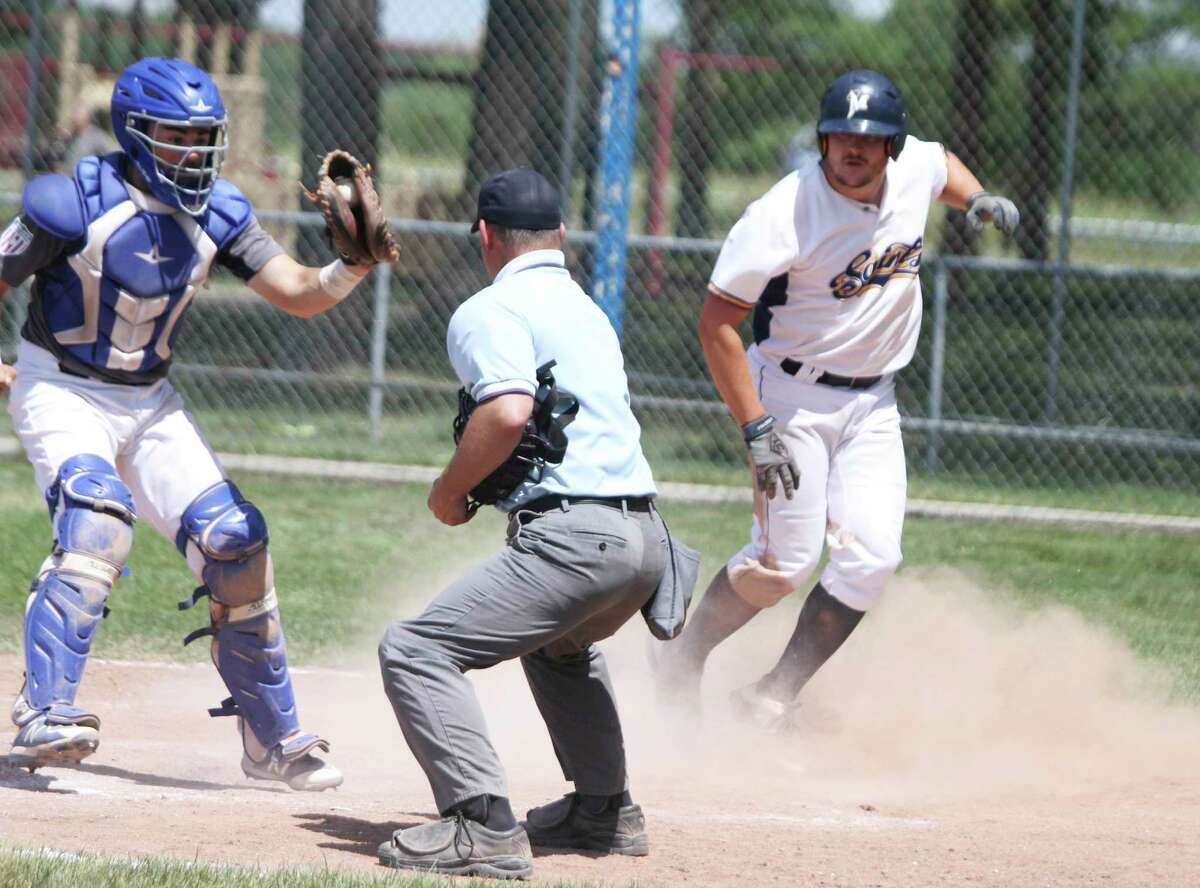 The Manistee Saints' Lucas Richardson waits to be called safe in a walk-off win last summer. The Saints kick off the 2021 season this weekend. (News Advocate file photo)