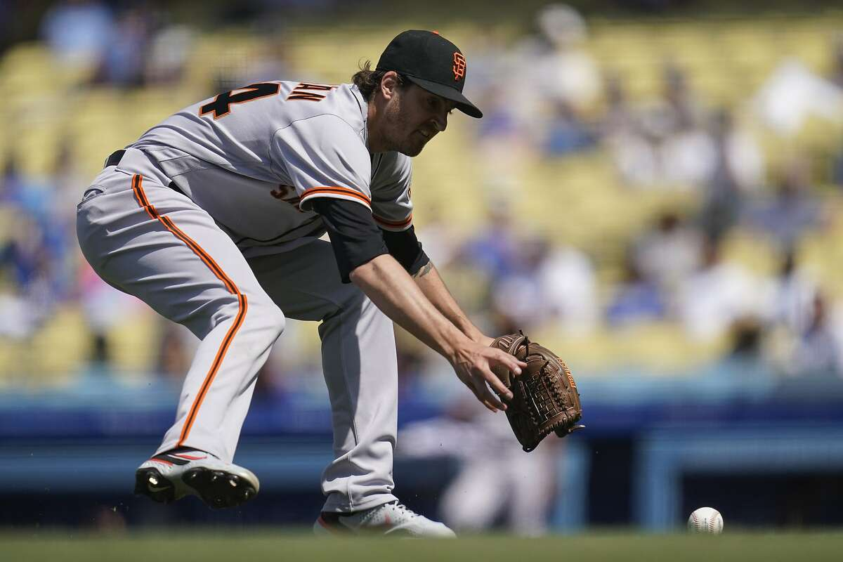 San Francisco Giants starting pitcher Kevin Gausman (34) fields a ground ball hit by Los Angeles Dodgers' Matt Beaty during the sixth inning of a baseball game Sunday, May 30, 2021, in Los Angeles. Beaty was out at first. (AP Photo/Ashley Landis)