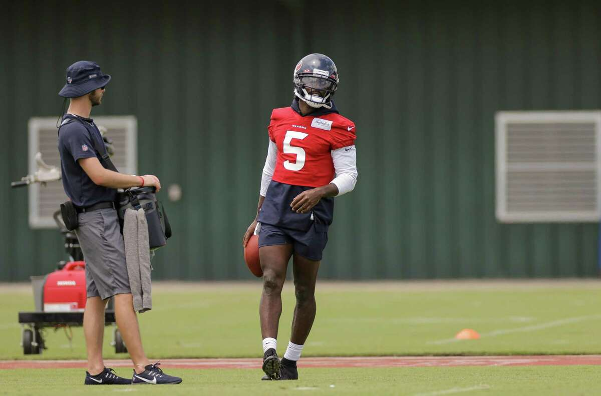 Houston Texans quarterback Tyrod Taylor (5) after going through a bad carrier drill during an OTA practice at the Houston Methodist Training Center on Thursday, June 3, 2021, in Houston.