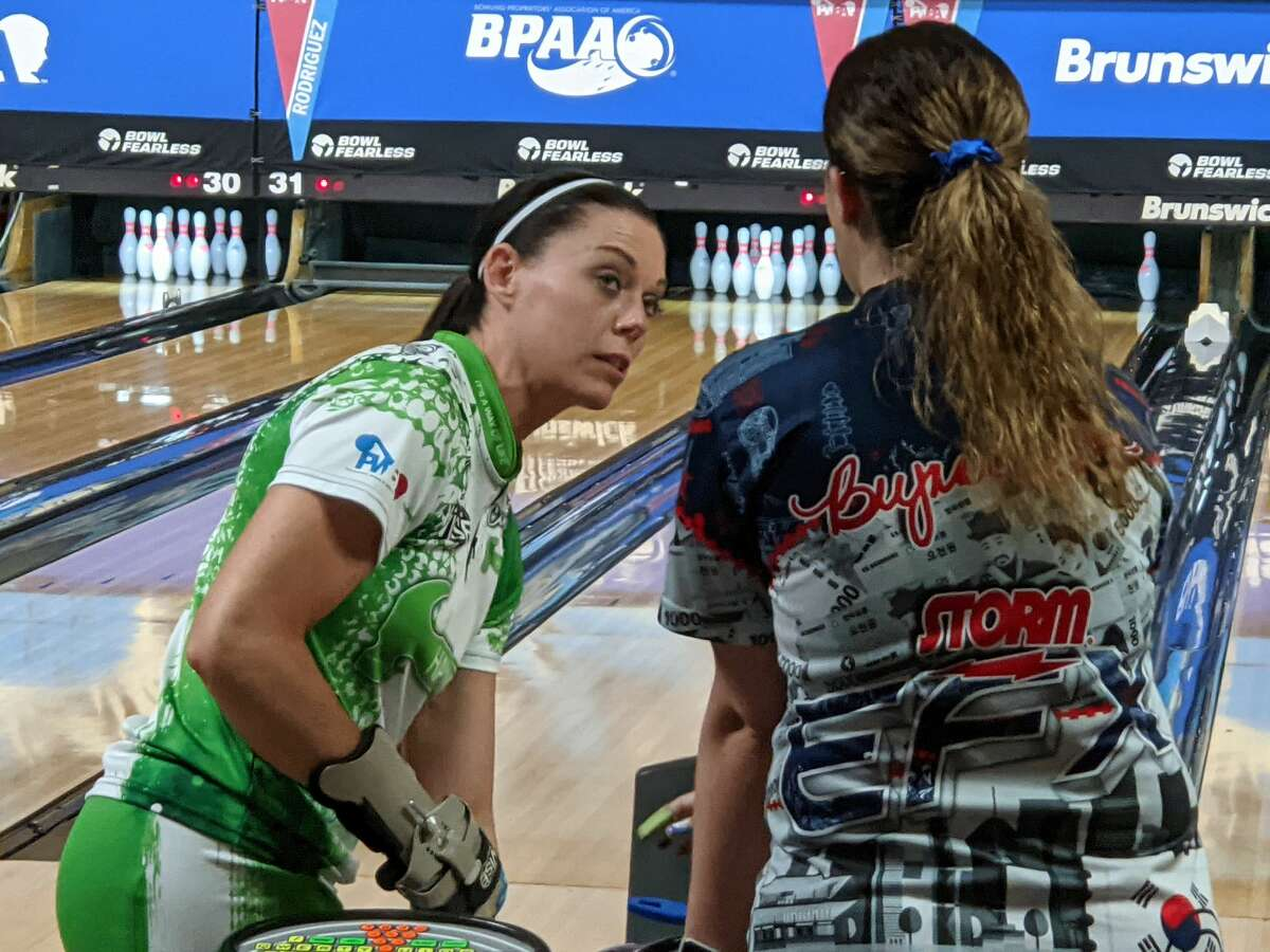 Shannon O'Keefe, left, chats with a fellow competitor Thursday, June 3, 2021, during a practice session for the PWBA Albany Open at Kingpin's Alley in South Glens Falls. (Pete Dougherty/Times Union)