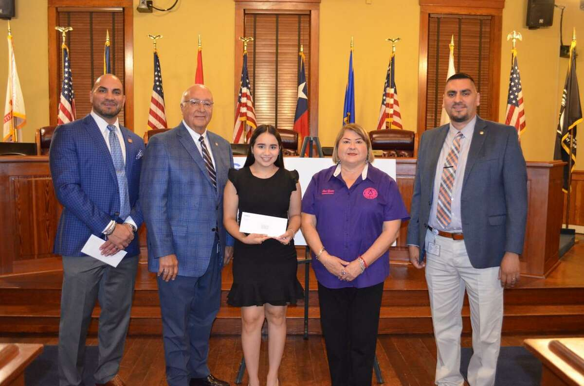 """For the 15th year, the GEO Group and the Webb County Commissioners Court awarded a total of $25,000 in scholarships to area students. Due to the coronavirus pandemic, no in-person ceremony was held. Pictured is one of the recipients from last year along with Judge Tano Tijerina and Webb County Commissioner """"Wawi"""" Tijerina."""