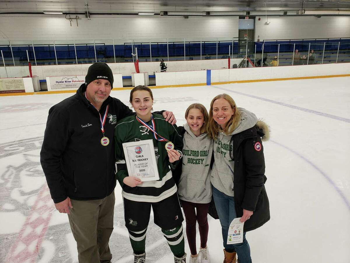 The Epke family celebrates Maddie (second to left) being named the 2020 SCC Girls Ice Hockey Player of the Year. Tom (far left) is an assistant coach on Guilford's ice hockey team.