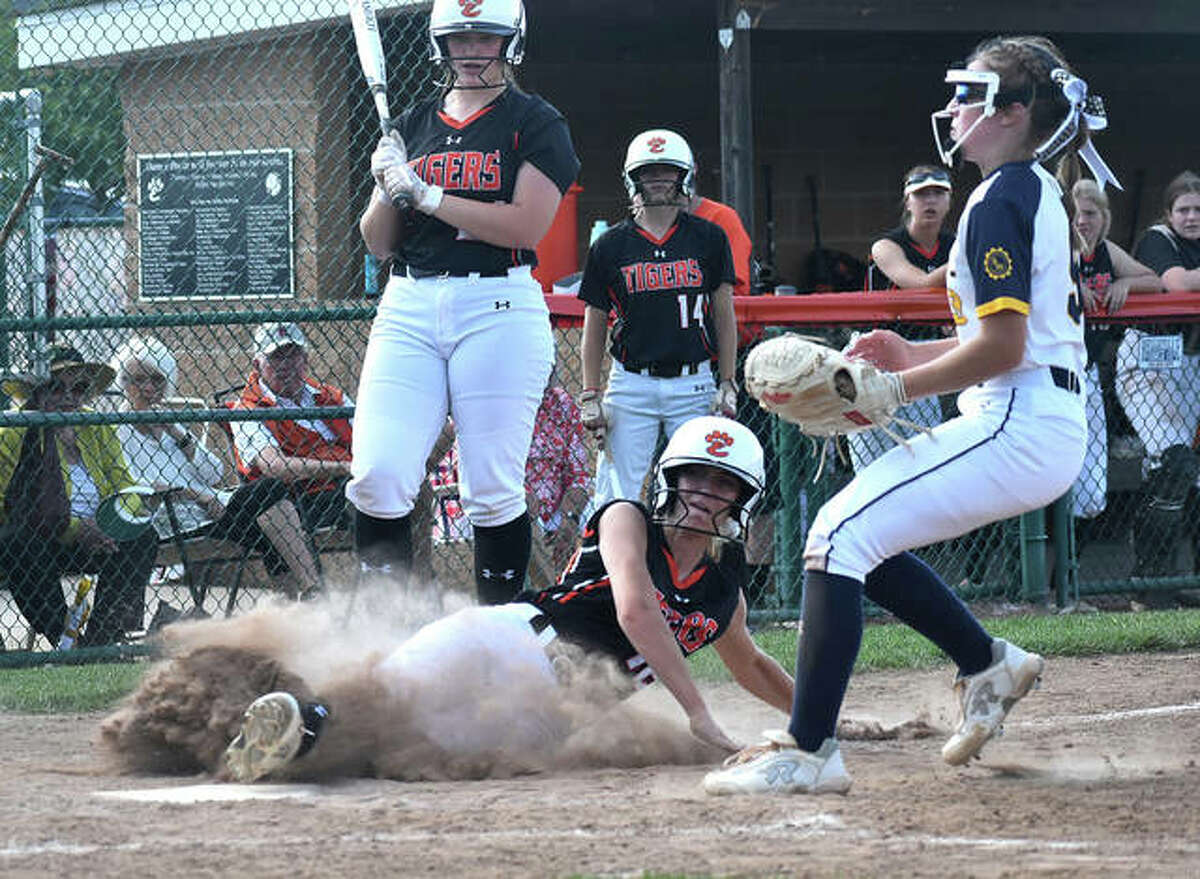 Edwardsville's Maci McNamee slides safely across home plate after a wild pitch against O'Fallon in the sixth inning of a Class 4A regional championship game inside the District 7 Sports Complex.