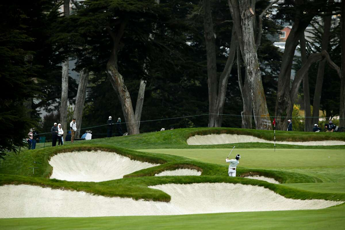 Lucy Li hits toward the No. 6 green during Thursday's first round. Li, from Redwood City, shot 2-over-par 73.