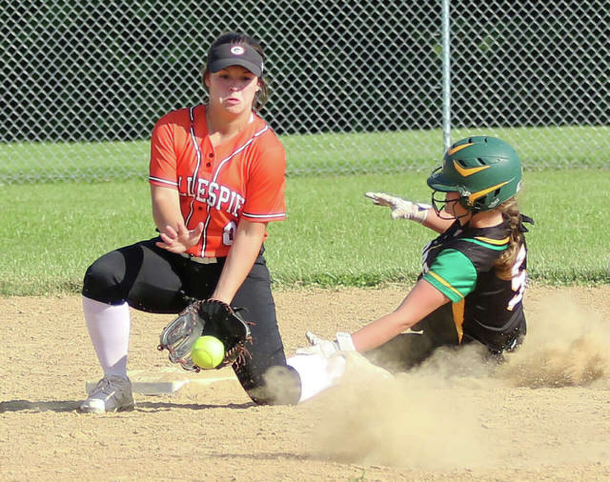 Gillespie shortstop Chloe Segarra (left) fields a throw while Southwestern's Madison Seymour slides in safe at second base in the sixth inning in a Class 2A regional semifinal Thursday in Piasa.