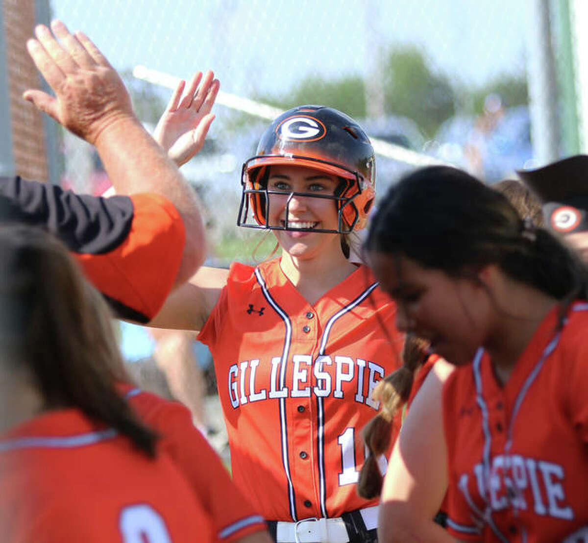 Gillespie's Keaton Link gets a high-five from a coach after her home run in the first inning Thursday in Piasa.