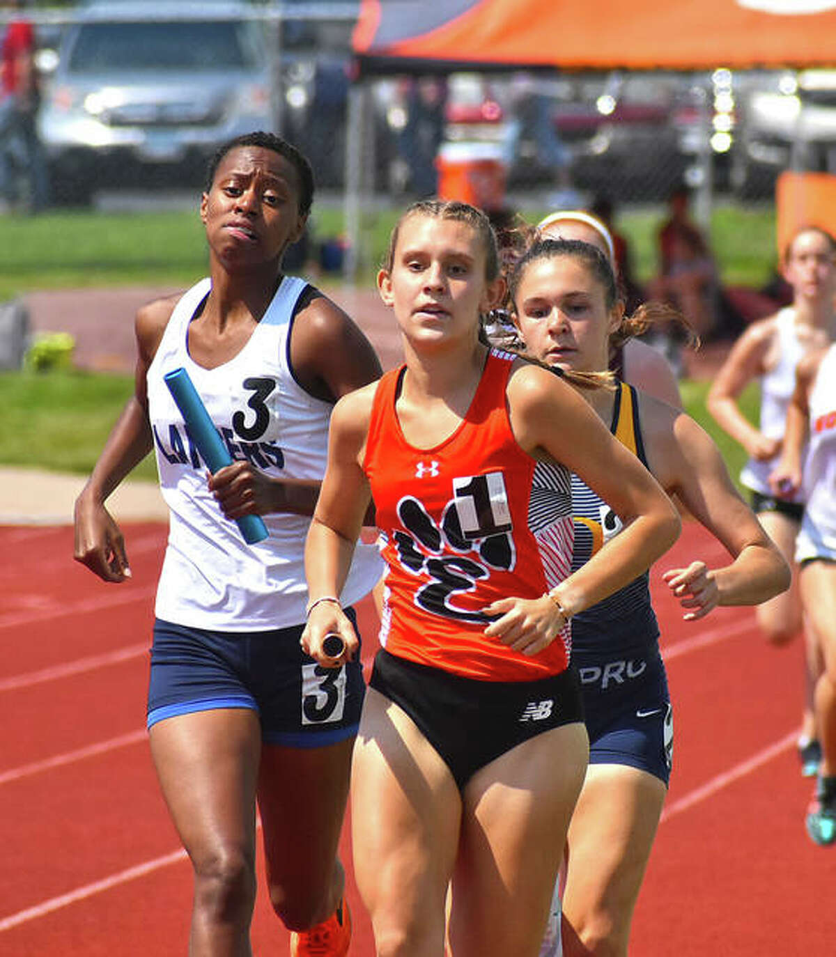 Edwardsville's Kaitlyn Loyet leads after the first lap of the 3,200-meter relay at the Class 3A O'Fallon Sectional on Thursday.