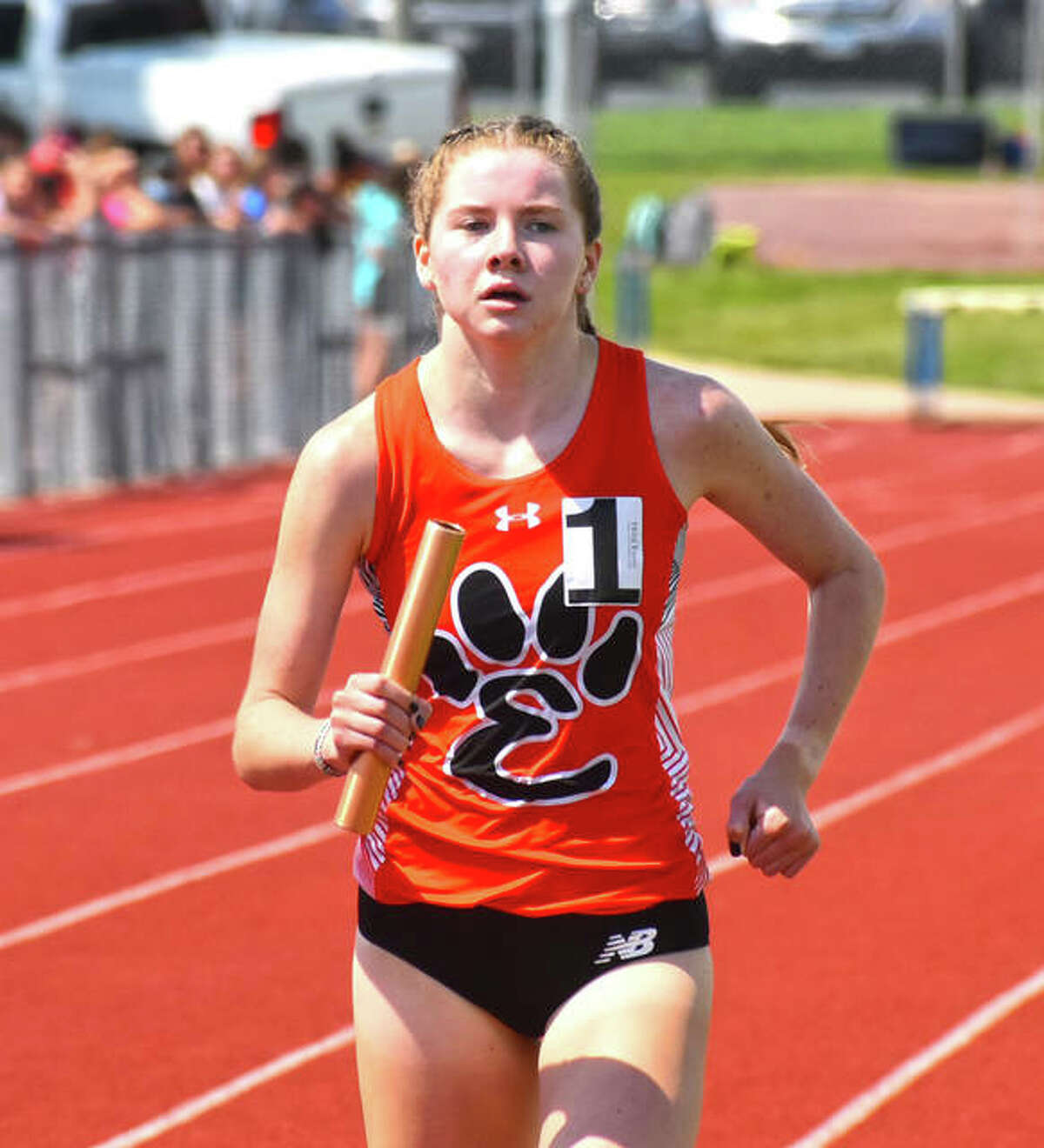 Edwardsville's Riley Knoyle finishes off the win in the 3,200-meter relay at the Class 3A O'Fallon Sectional on Thursday.