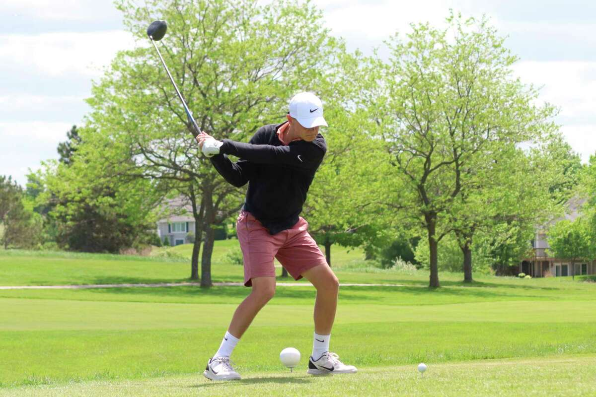 Ethan Novak golfs for the Huskies earlier this year. (Record Patriot file photo)