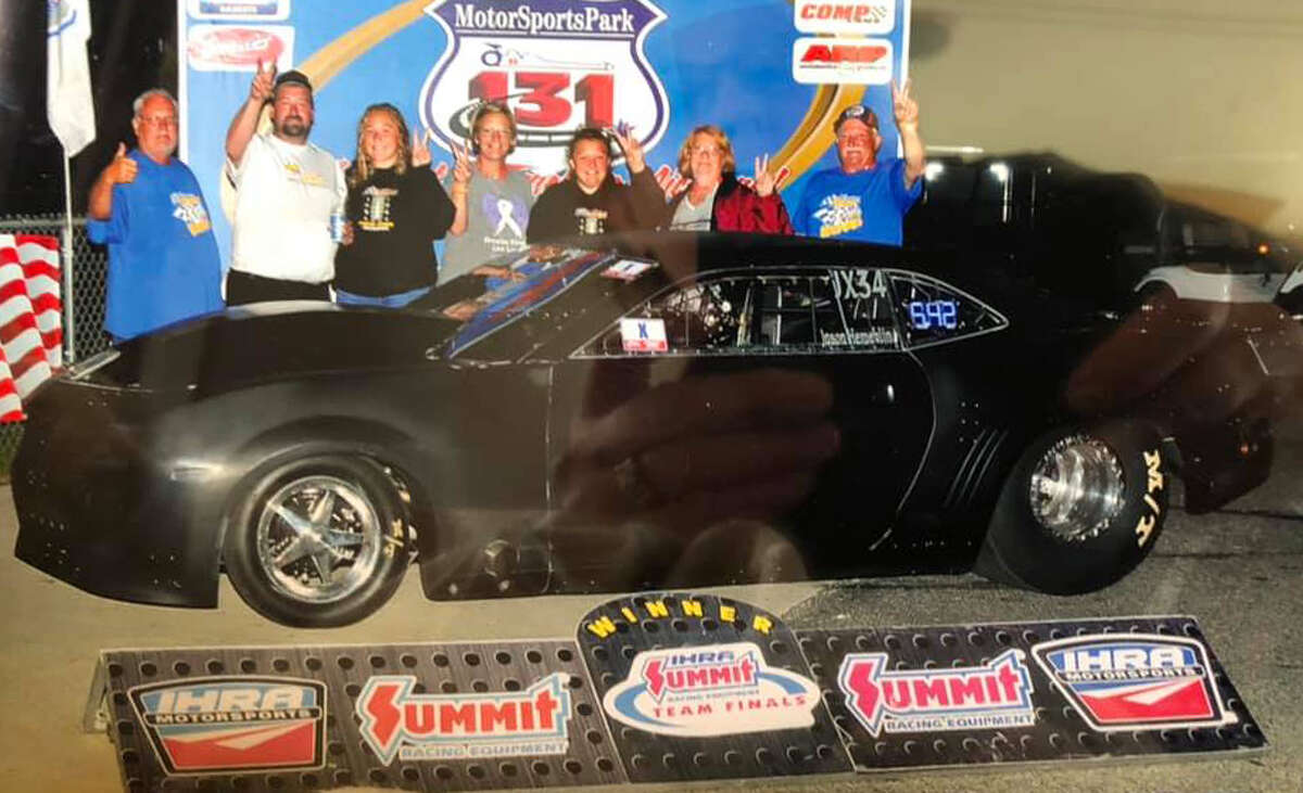 Unionville's Jason Hemerline, second from left, poses with family and friends in front of his 2013 Chevy Camaro dragster.