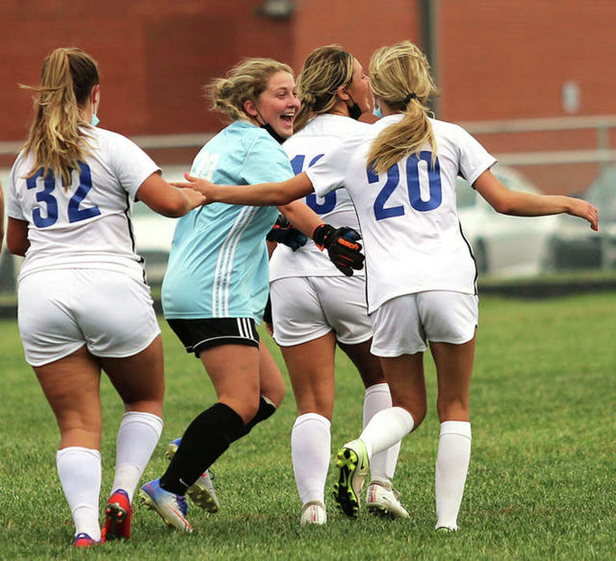 Carlinville goalie Matilda Mitchell (second left) races to midfield to join teammates in Isabelle Stoops (32) and Jill Stayton (20) and Maycee Gall after Stayton's game-tying goal late in the second half of a Class 1A regional match against Southwestern in Piasa.