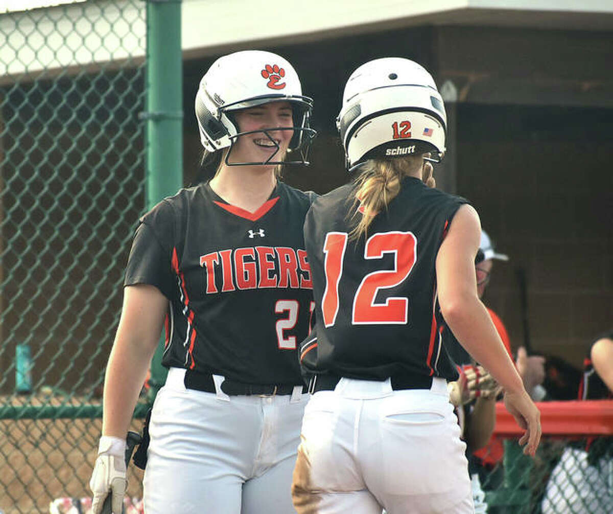 Edwardsville's Lexie Griffin (left) congratulates Maci McNamee after she scored on a wild pitch against O'Fallon in the sixth inning of a Class 4A regional championship game inside the District 7 Sports Complex. Griffin homered the the Tigers' win.