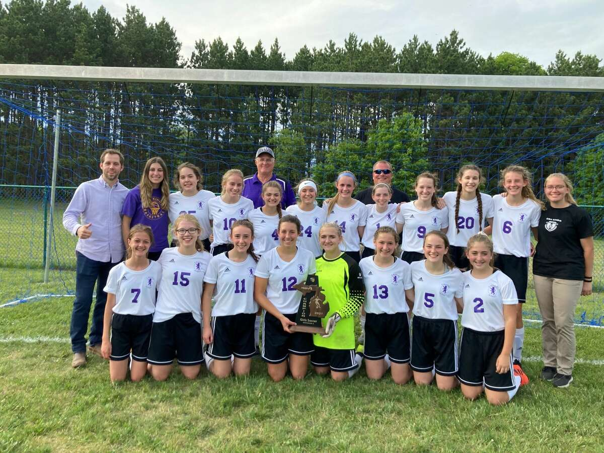 Members of Calvary Baptist's girls' soccer team which won a first-ever district championship on Thursday are (front, from left) Shiloh Coston, Hailey Lewis, Amanda Wiggins, Caroline Holdeman, Emma Schmidt, Illa Tomko, Kayla Grabill, Natalie Schmidt; (middle, from left) coach Paul Reece, Caroline Houtman, Tori Ginac, Alyvia Kryger, Hannah Schmidt, Madi Childs, Sage Arnold, Peyton Laughner, Caitlyn Dickerson, Claire Theaker, Lillian Holdeman, assistant coach Savannah Wallace; and (back, from left) assistant coach Dale Moore and assistant coach Jason Warner.