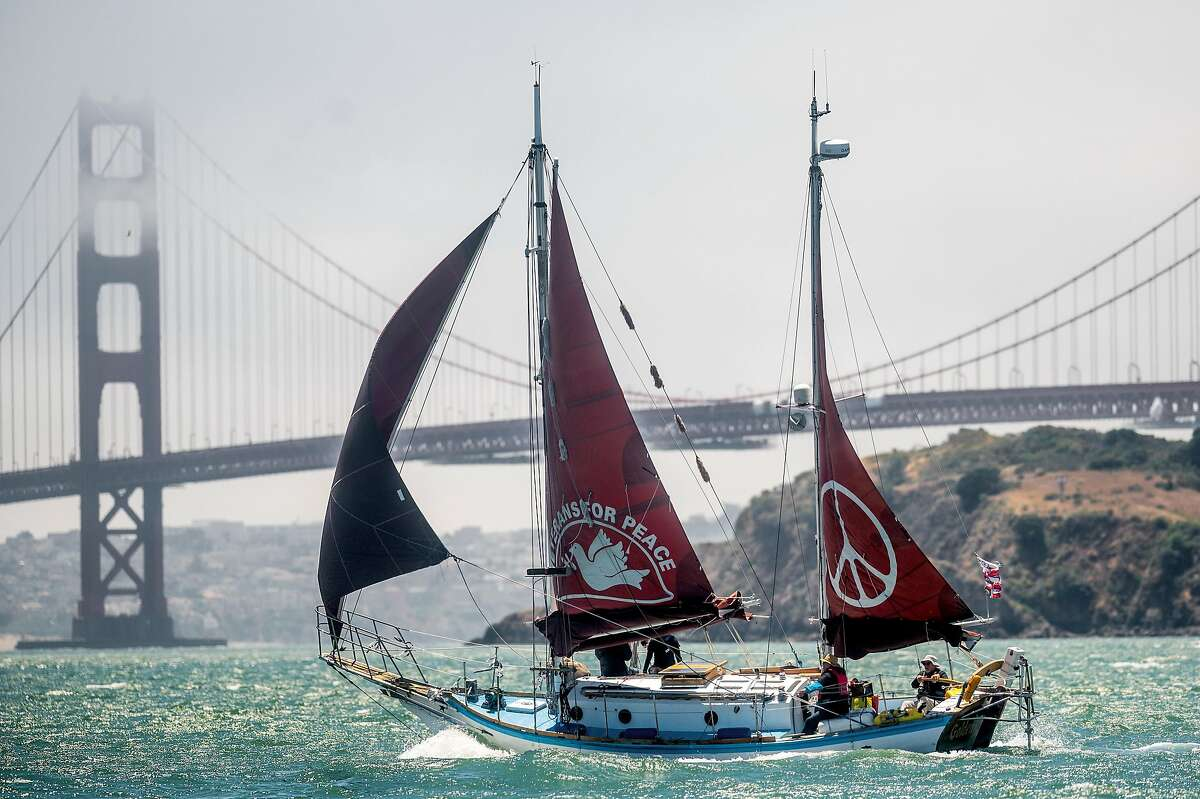 The Golden Rule, a ketch that sails to advocate for abolishing nuclear weapons, passes the Golden Gate Bridge while en route from Sausalito to Berkeley.