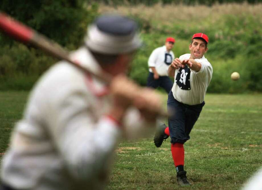 Pitcher Dennis Norwich of Newtown delivers to the plate for the Newtown Sandy Hooks in their vintage baseball game with the Gotham Baseball Club of New York at the Fairfield History Center's annual Fall Festival on Sunday, September 12, 2010. Photo: Brian A. Pounds / Connecticut Post