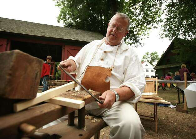Peter Bilyard of Fairfield shapes a piece of wood on a shaving horse as he demonstrates the uses of antique tools at the Fairfield Museum and History Center's annual Fall Festival on Sunday, September 12, 2010. Photo: Brian A. Pounds / Connecticut Post