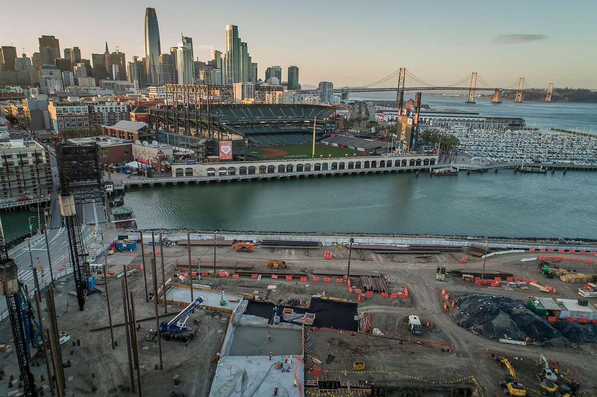 Construction crews pour concrete in a section of the new Mission Rock development near Oracle Park in San Francisco, Calif., on Wednesday, April 7, 2021. The development, a collaboration between the San Francisco Giants, Tishman Speyer, and the Port of San Francisco is building with the impending sea level rise in mind and elevating the ground level.