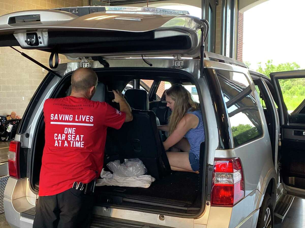 Spring Fire Department employees check the car seats during an event May 27. Another inspection event will be held from 10 a.m. to 1 p.m. June 24 at Spring Fire Station No. 74, 23803 Aldine Westfield Road.