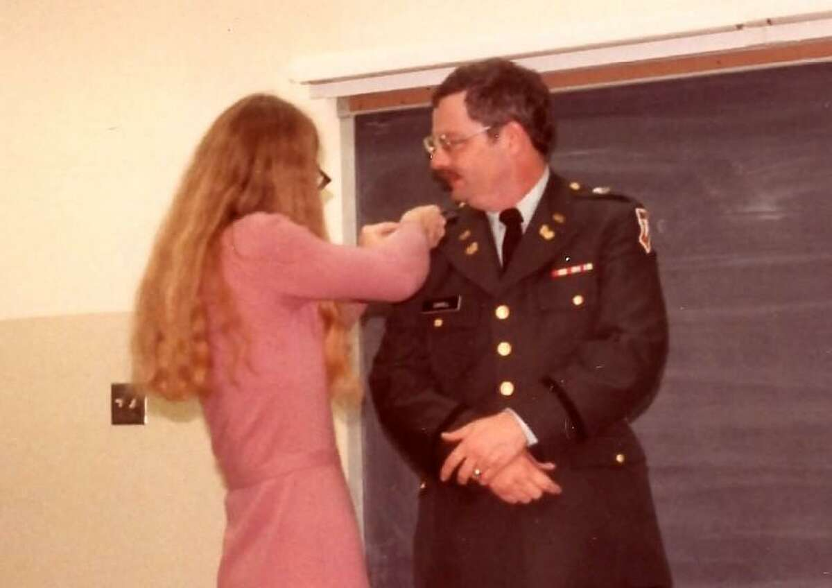 Joleen Cahill pins a lapel on Michael Cahill during a ceremony designating him as a U.S. Army Chief Warrant Officer 2 in 1985.