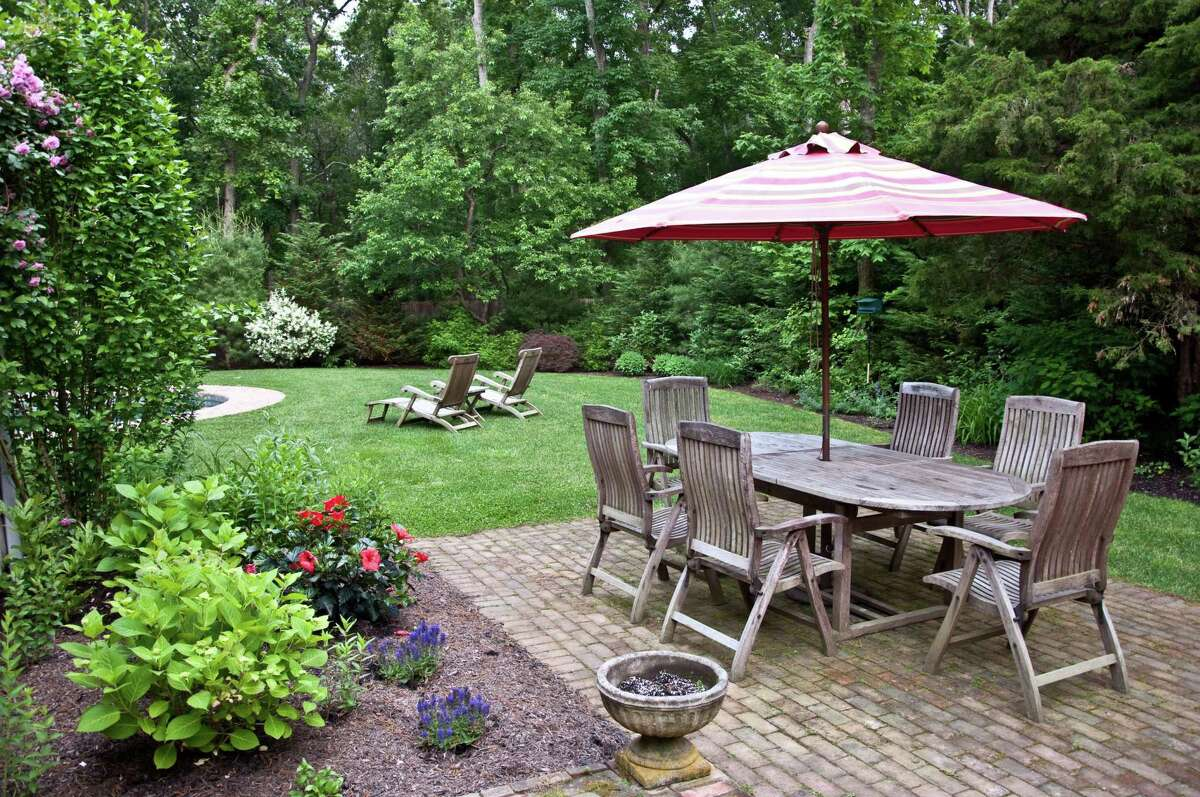 In general, it costs less to build a patio than a deck, according to Bob Vila.