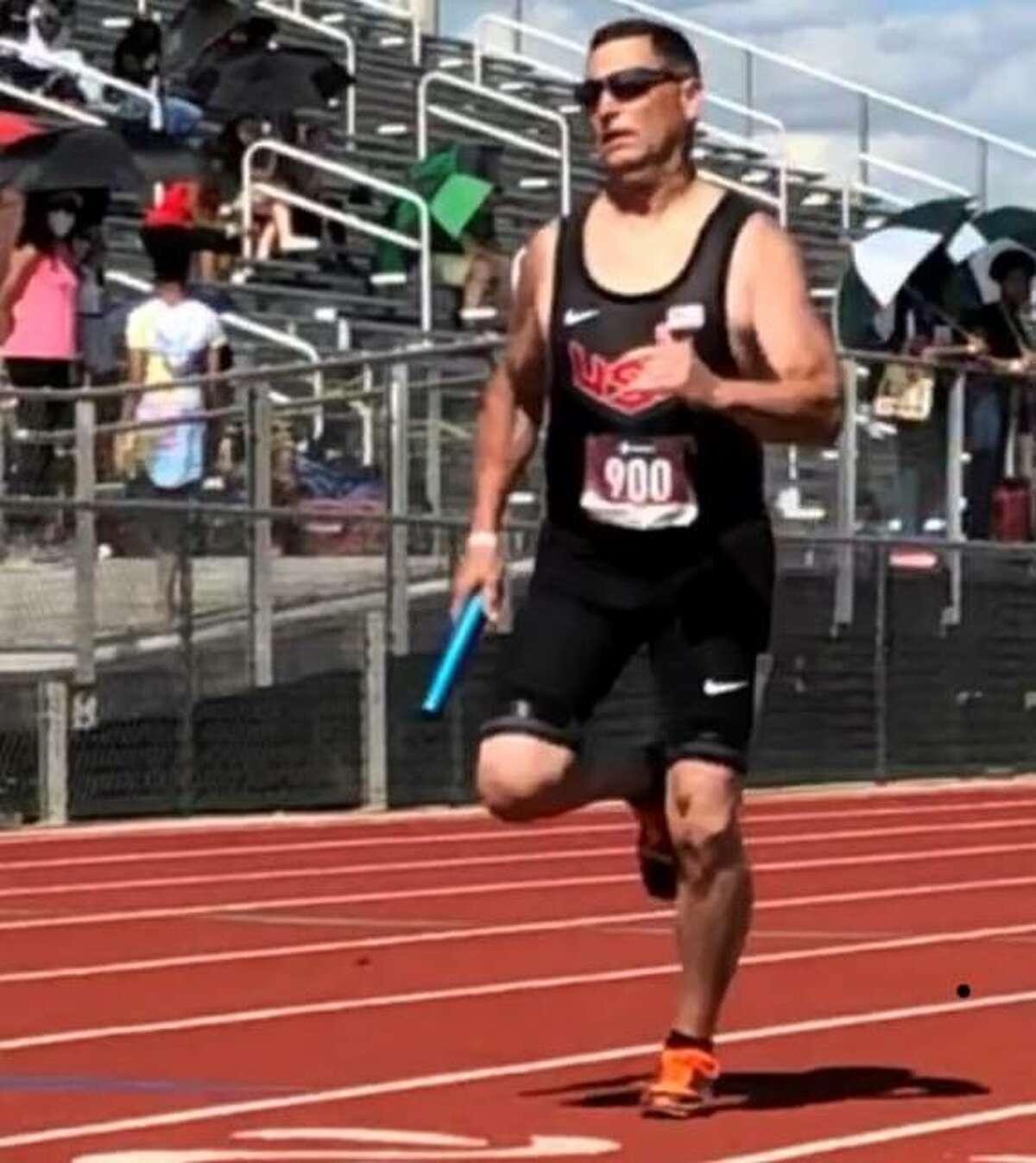 Mike Young of Wood River runs his leg of the 4 x 100 relay Sunday at the Atlanta International Relays meet at McDonough County High School in suburban Atlanta.