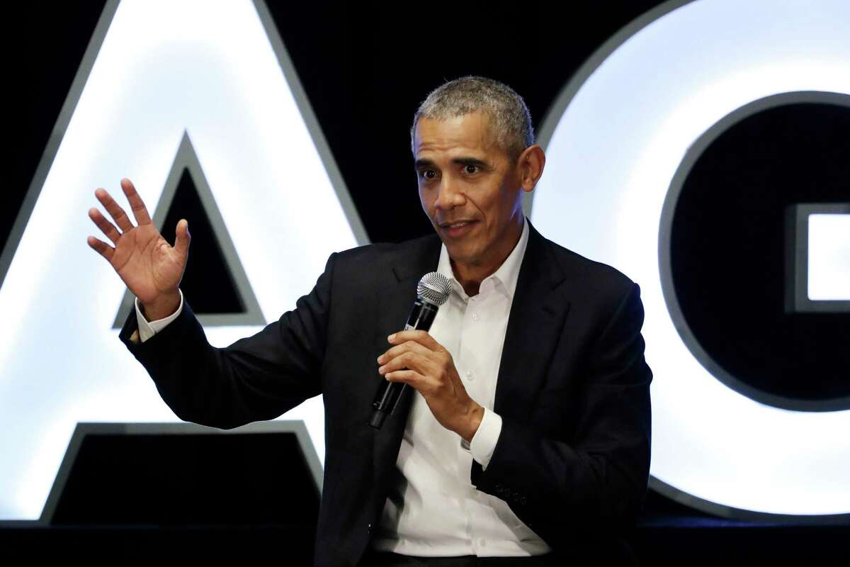 FILE - In this Feb. 15, 2020, file photo, former President Barack Obama talks during a panel with NBA players Chris Paul, Kevin Love and Giannis Antetokounmpo and sports analyst Michael Wilbon in Chicago. Obama tipped his cap. So did three other former presidents and a host of prominent civil rights leaders, entertainers and sports legends in a virtual salute to the 100-year anniversary of the founding of baseball's Negro Leagues. The campaign launched Monday, June 29, 2020, with photos and videos from, among others, Hank Aaron, Rachel Robinson Derek Jeter, Colin Powell, Michael Jordan, Obama and presidents George W. Bush, Bill Clinton and Jimmy Carter at tippingyourcap.com. (AP Photo/Nam Y. Huh, File)