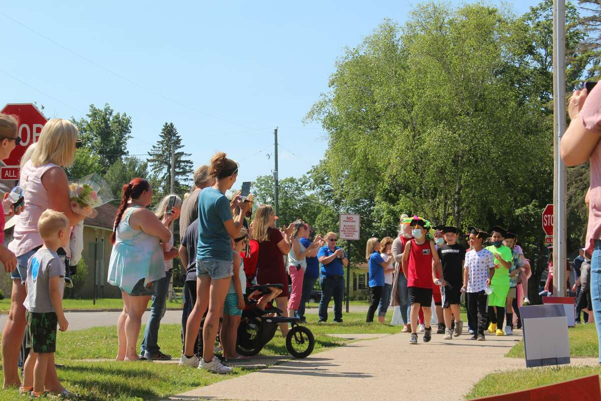 Brookside Elementary teachers, parents and families gathered outdoors on Friday to celebrate the last day of school for the elementary's 4th grade classes who donned decorated celebratory graduation caps.