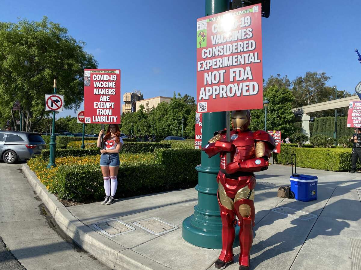 One protester, dressed up as Iron Man, protests by the Disneyland entrance.