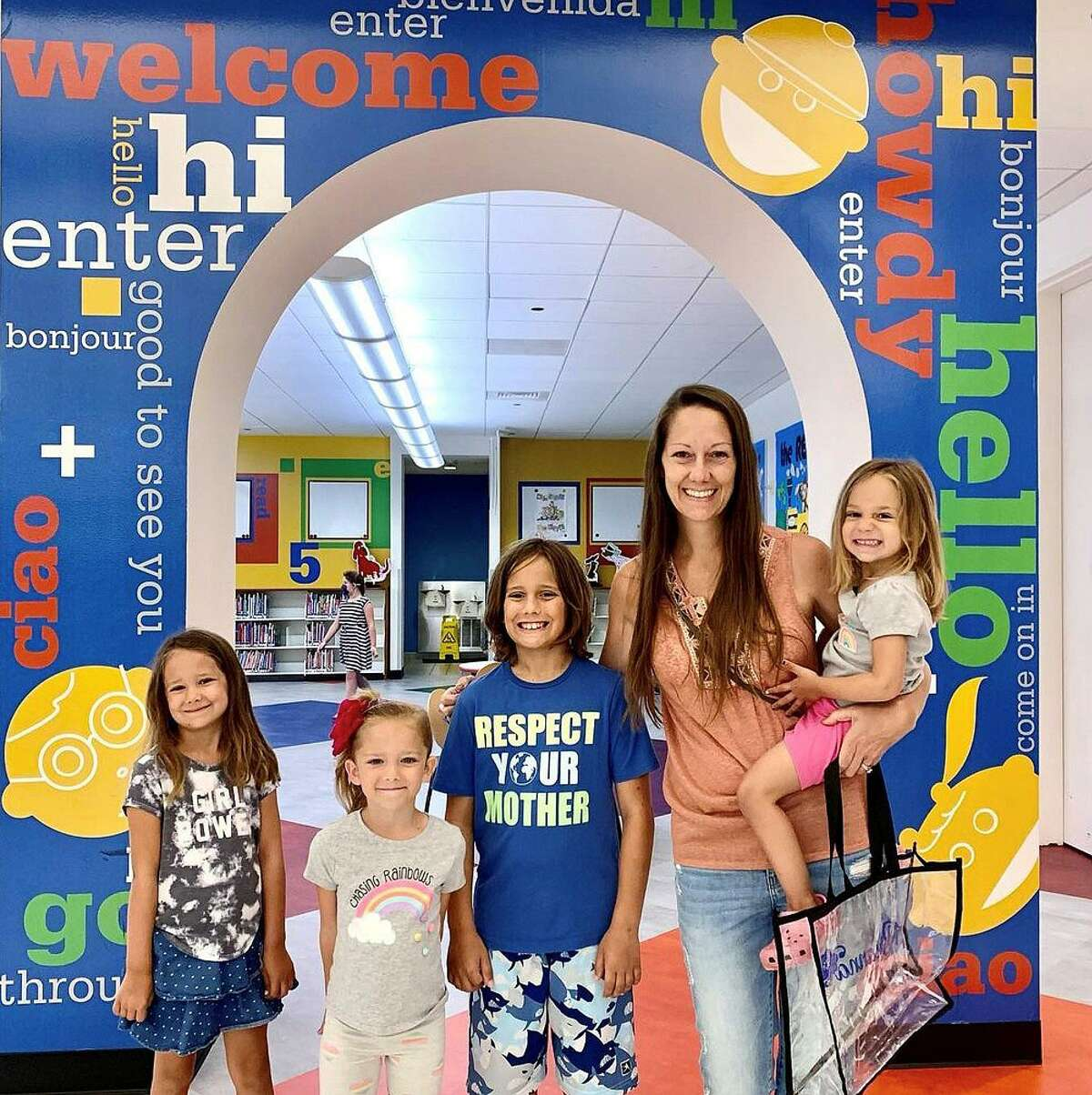 This family is all smiles after a visit to their local library after the doors were reopened to the public recently. A beautifully decorated sallyport welcomes back the public.