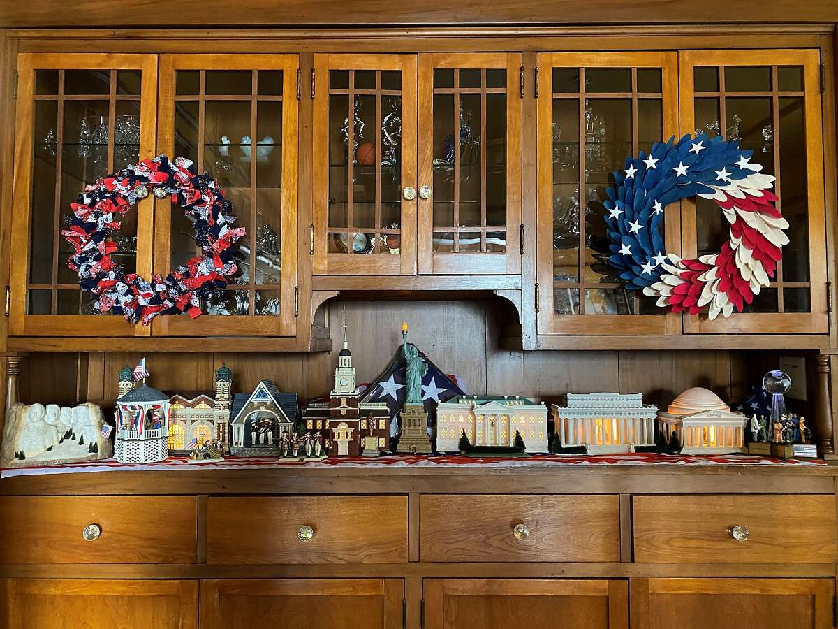 A patriotic miniature village set up at the Fisher-Paulson household pays tribute to Memorial Day and Flag Day.