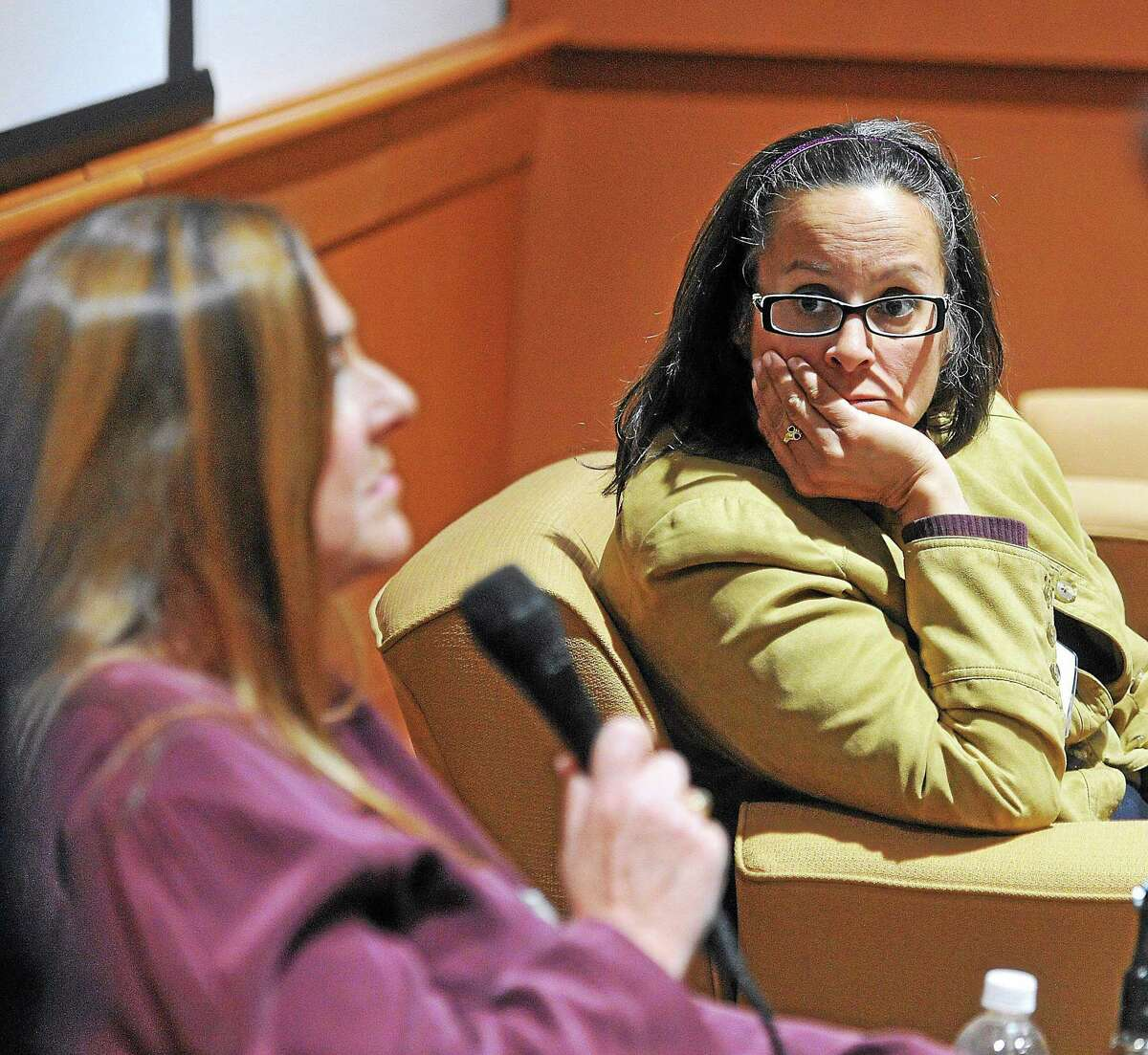 Panelists Dr. Dorothy Stubbe, left, and Kathy Flaherty, right, field questions as mental health professionals and law experts participate during a 2017 symposium at Quinnipiac University on gun violence.