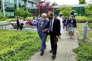 Congressman Paul Tonko, left, and UAlbany President Havid‡n Rodr'guez, talk as they walk to the RNA Institute at UAlbany on Wednesday, June 2, 2021, in Albany, N.Y.   (Paul Buckowski/Times Union)