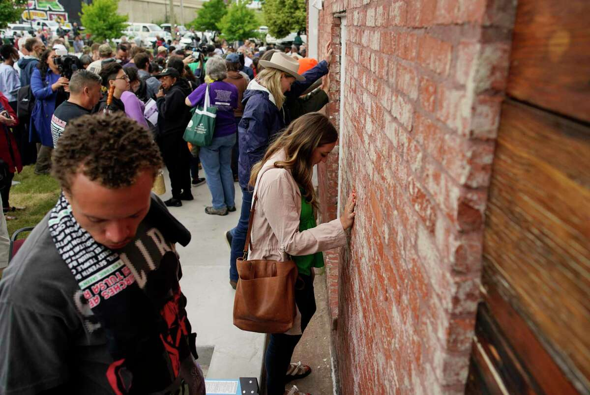 People at a prayer wall outside the historic Vernon African Methodist Episcopal Church in the Greenwood neighborhood remember the Tulsa Race Massacre. It was not the only such massacre.
