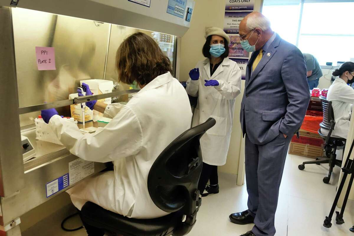Janet Lynch, left, a research scientist at RNA Institute, and Sharon Shaughnessy, second from left, surveillance testing coordinator at the institute, talk with Congressman Paul Tonko, who was touring the Covid Surveillance Testing Lab, part of the RNA Institute at UAlbany, on Wednesday, June 2, 2021, in Albany, N.Y. (Paul Buckowski/Times Union)