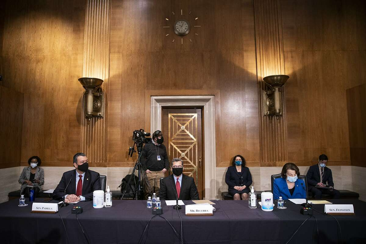 California Sens. Alex Padilla (front left) and Dianne Feinstein (front right) play a critical role in nominating judges. Here, they're flanking Xavier Becerra in his confirmation hearing as health secretary.