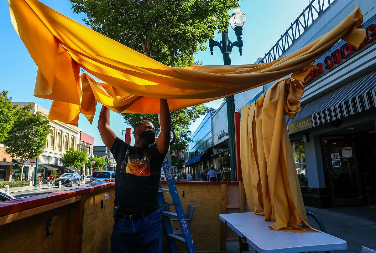 Chadwick Spell adds a covering to the new parklet for wine lounge KARIBU by Wachira in Alameda.
