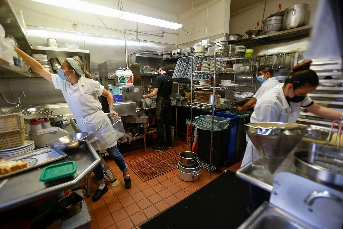 Employees say Flea Street Cafe's service charge dissolved traditional barriers between the kitchen and servers.