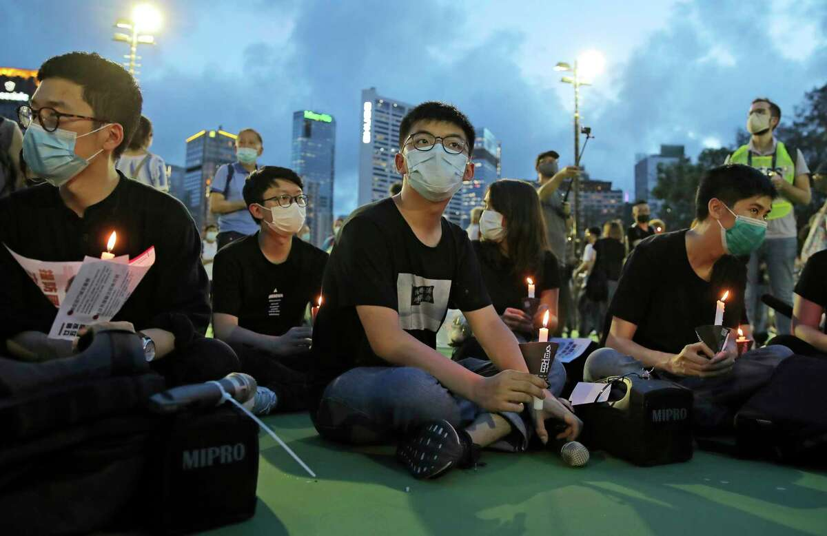 Democracy activist Joshua Wong, center, has been imprisoned for speaking truth to power. Manipulation of the truth is the ground game of authoritarians and propagandists - and it's destabilizing to a democracy like ours.