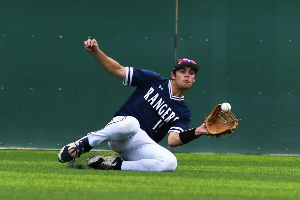 Smithson Valley's Tim Arguello slides to catch a pop-fly in the bottom of the second inning of Friday's Region IV-6A playoff game against Los Fresnos. Arguello also drove in Ryan Ruff for the winning run in the top of the seventh.