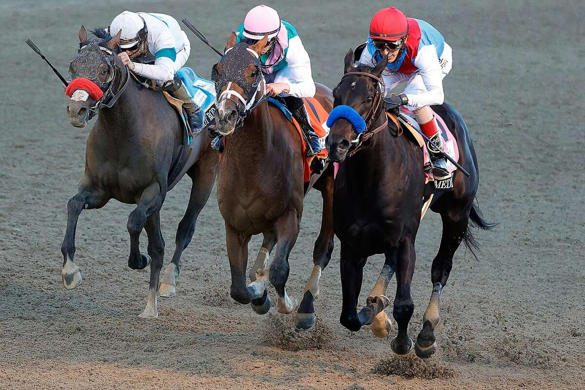 FILE - MAY 9, 2021: It was reported that Kentucky Derby winner Medina Spirit failed a post-race drug test and has tested positive for elevated levels of betamethasone, an anti-inflammatory corticosteroid May 9, 2021. LOUISVILLE, KENTUCKY - MAY 01: Medina Spirit #8, ridden by jockey John Velazquez, (R) crosses the finish line to win the 147th running of the Kentucky Derby ahead of Mandaloun #7, ridden by Florent Geroux, and Hot Rod Charlie #9 ridden by Flavien Prat , at Churchill Downs on May 01, 2021 in Louisville, Kentucky. (Photo by Tim Nwachukwu/Getty Images)