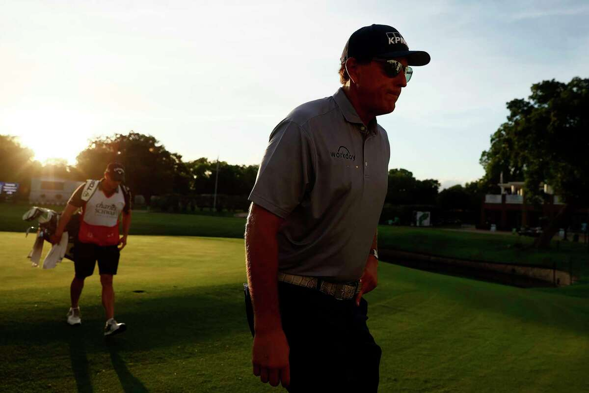 FORT WORTH, TEXAS - MAY 28: Phil Mickelson walks off the 18th hole following the second round of the Charles Schwab Challenge at Colonial Country Club on May 28, 2021 in Fort Worth, Texas.