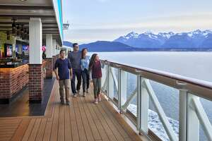A family enjoys The Waterfront, an oceanfront promenade, on a Norwegian Bliss sailing in Alaska