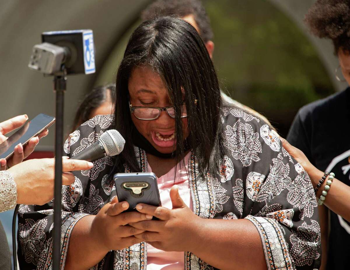 Yolanda Richardson, the mother of a girl who was allegedly abused by a bus monitor, gets emotional as she reads a statement on her phone during a press conference outside the Albany County Courthouse on Friday, June 4, 2021 in Albany, N.Y.(Lori Van Buren/Times Union)
