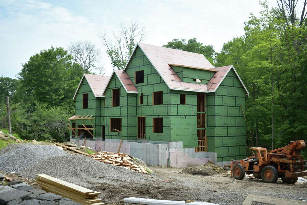 A Guinea Road home under construction in Greenwich, Conn., which cleared May as Fairfield County's hottest real estate market for the first five months of 2021 with sales running double their levels of a year earlier.