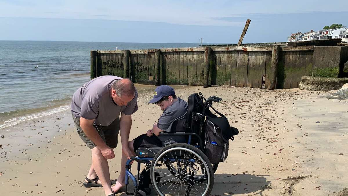 Ray Thomas helps his son RJ on Hawks Nest Beach in Old Lyme.