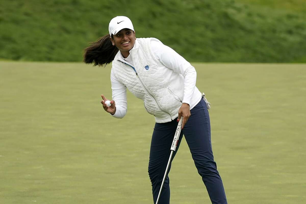 Megha Ganne waves after making her putt on the eighth green during the second round of the U.S. Women's Open.