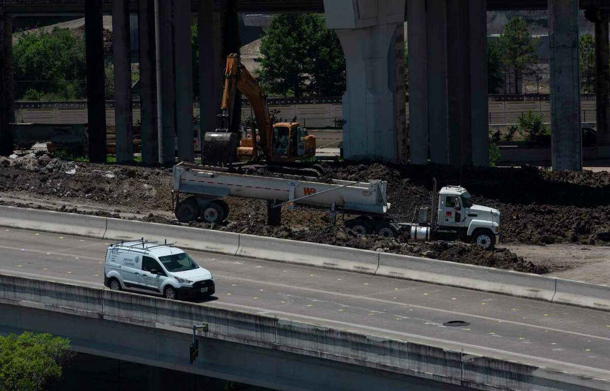 Traffic passing construction equipment on ramp connecting Loop 610 to Interstate 69 northbound May 6, 2021, in Houston. Crews will close I-69 in both diorections at Loop 610 at 9 p.m. June 11, according to the Texas Department of Transportation and the lanes will reopen by 5 a.m. June 14.