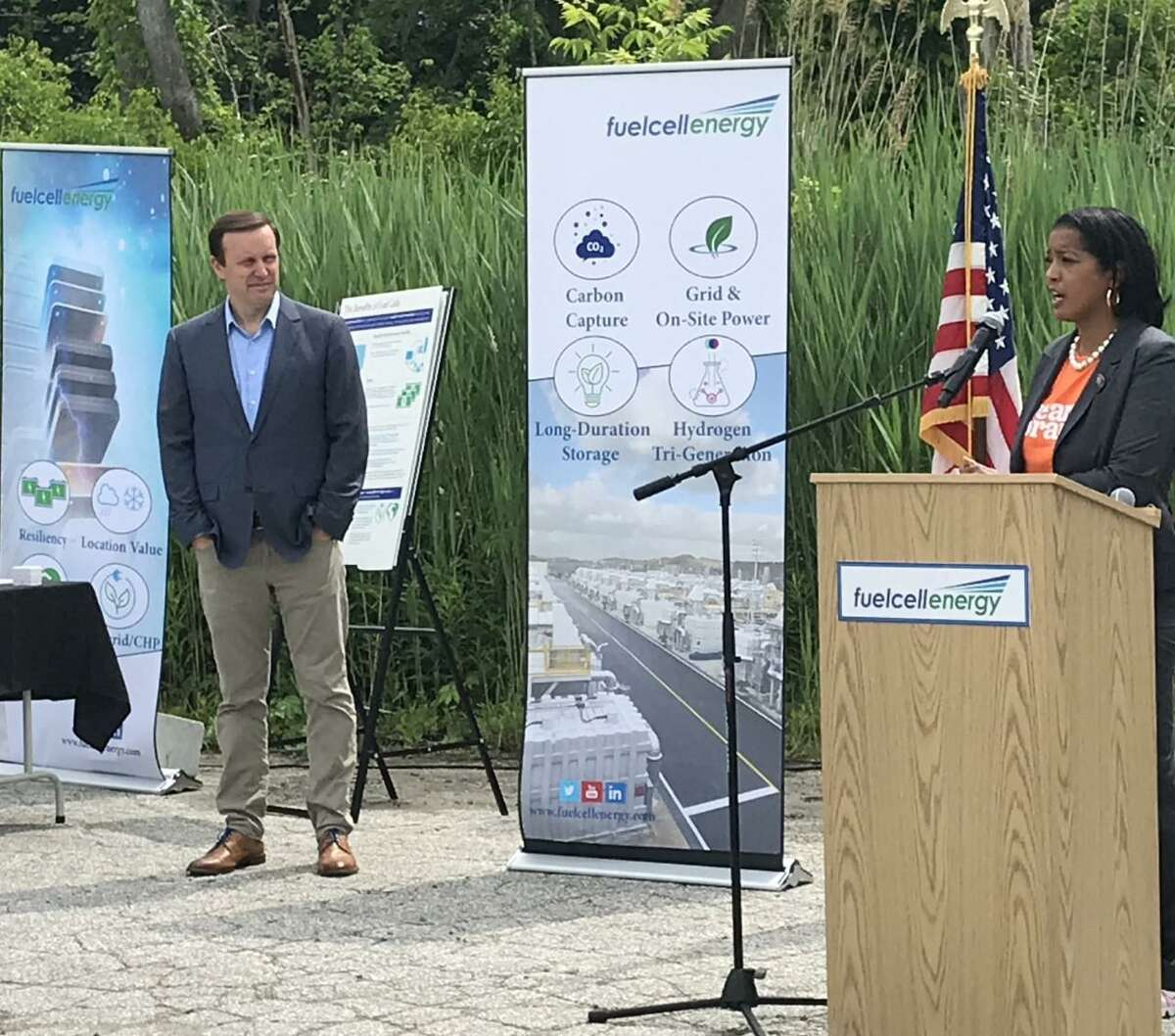 U.S. Representative Jahana Hayes (D-5) addresses workers at FuelCell Energy in Danbury on Friday as U.S. Senator Chris Murphy looks on. The two lawmakers toured the company's headquarters and research facility.